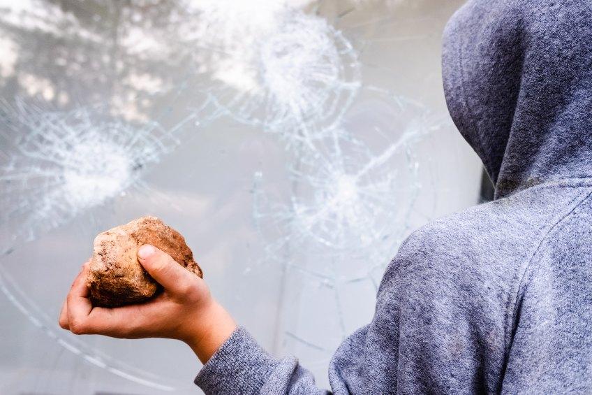 intruder throwing rock at window